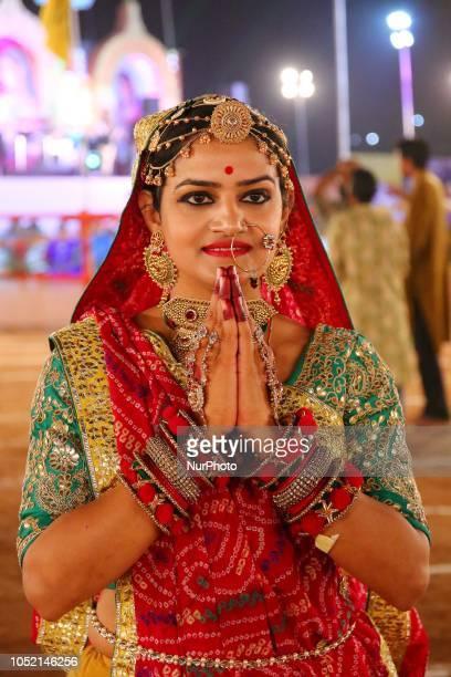 Indian men and women perform Garba amp Dandiya dance during the Navratri festival 'nine days' celebration in JaipurRajasthanIndia on Oct...