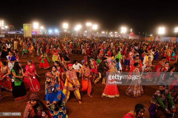 Indian men and women perform Garba amp Dandiya dance during the Navratri festival 'nine days' celebration in JaipurRajasthanIndia on Oct...