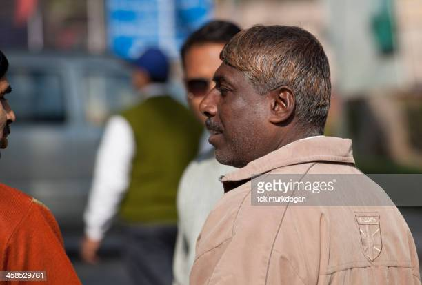 indian men are talking at street of agra india - men stockfoto's en -beelden