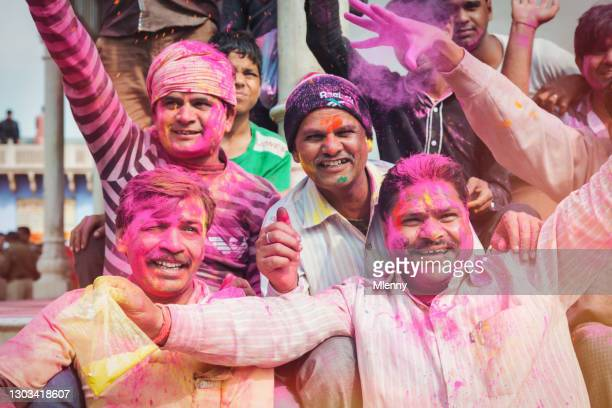 indian men celebrating holi festival in rajasthan india at holi festival - mlenny stock pictures, royalty-free photos & images