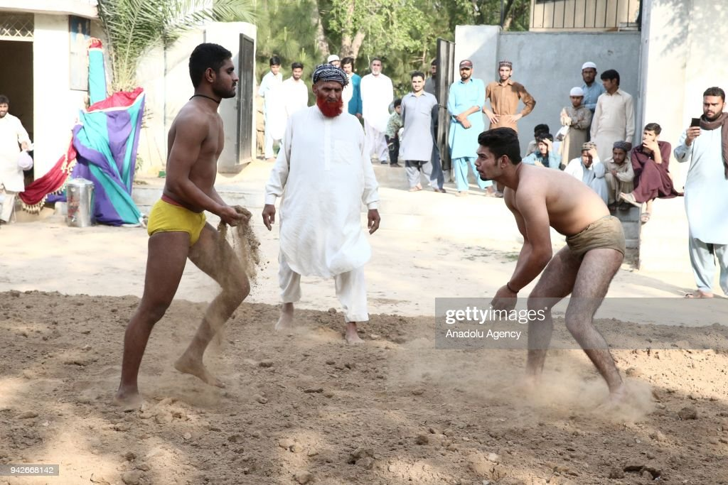 Indian men compete `Kushti` at Liaqat Bagh in Rawalpindi Pakistan on April 6 2018 Kushti is a traditional wrestling sport that is common in India and.