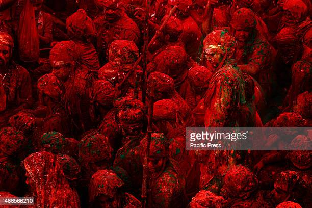 NANDGAON MATHURA UTTARPRADESH INDIA Indian men drench in colors of kesudo naturally occurring orangered dye and palash Holi is also known as the...