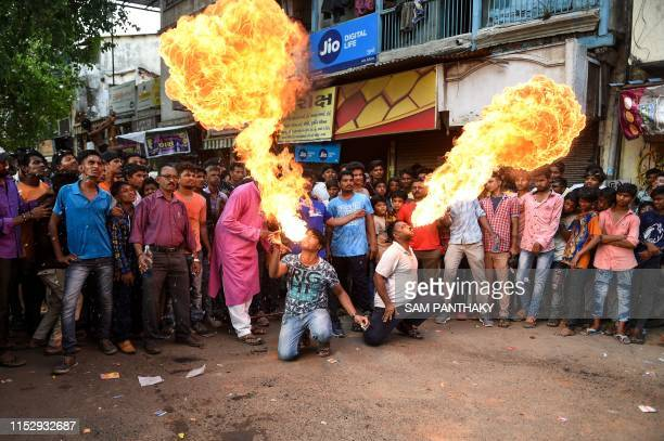 Indian men Nitinbhai Lodha and Sunil Rana spit fire during the rehearsal for the forthcoming Lord Jagannath Rath Yatra an annual Hindi festival...