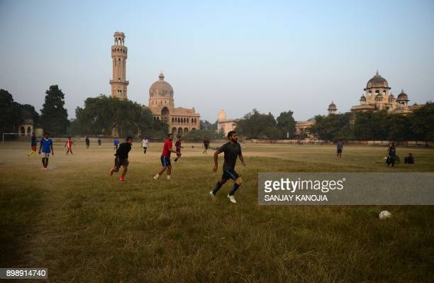 Indian men play football at the Allahabad University campus in Allahabad on December 13, 2017. / AFP PHOTO / SANJAY KANOJIA