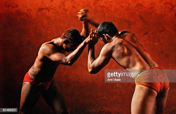 Indian men practice the three thousand year old sport known as Kushti a form of wrestling in its traditional form at the fight club Shahupuri on...