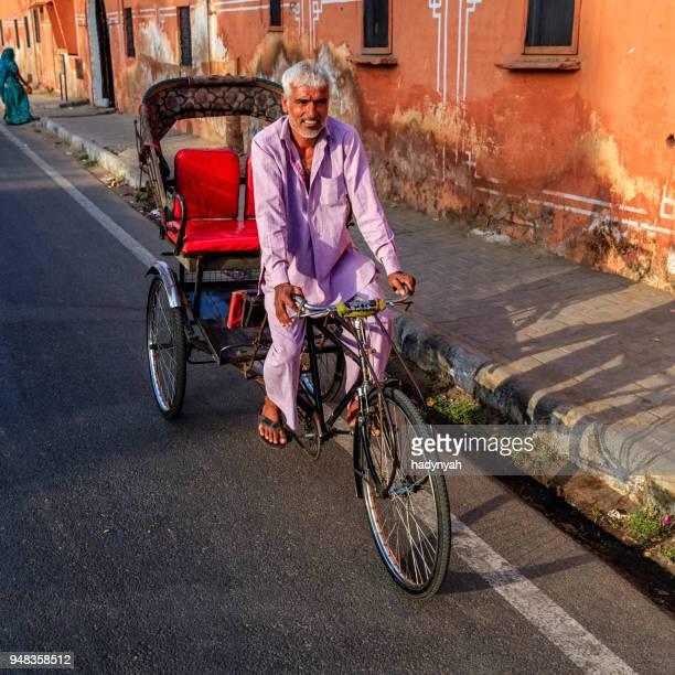 indian men ride cycle rickshaw, india - rickshaw stock photos and pictures