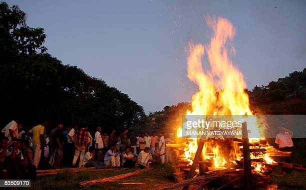 Indian men take part in a mass cremation at Hengrawadi village in Guwahati on October 31 2008 for victims of the October 30 2008 serial blasts A...