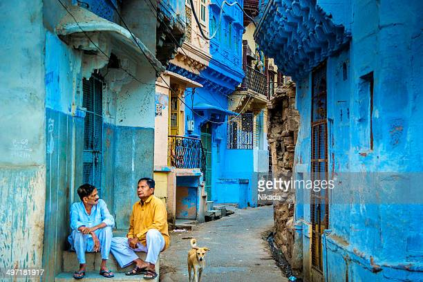 indian men talking outside their house on the street - jodhpur stock pictures, royalty-free photos & images