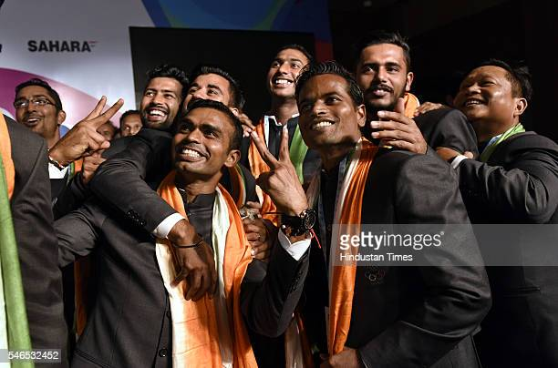 Indian men's Hockey team captain PR Sreejesh with team members pose for selfie during the announcement and introduction ceremony of the Indian Hockey...