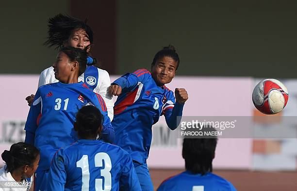 Indian midfielder Ngangom Bala Devi headers the ball for her team's second goal against Nepal during the final of the 3rd South Asian Football...