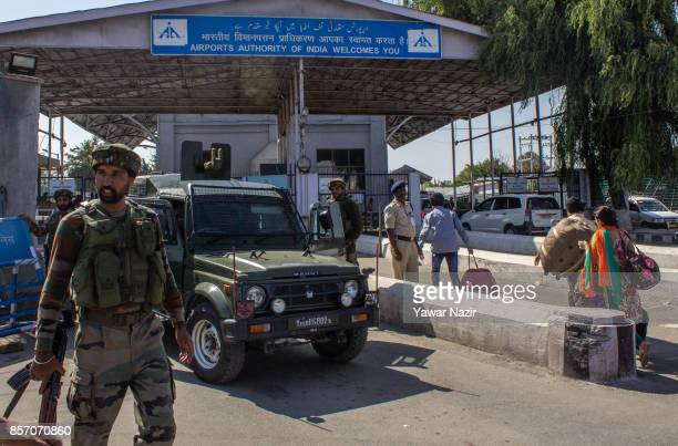 Indian military forces stand guard outside the International airport during a gun battle between suspected militants and them on October 3 in...