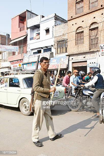 Indian military man on traffic duty