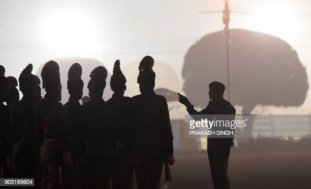 Indian military personnel get instructions to march as they rehearse for the forthcoming Republic Day parade on Rajpath in New Delhi on January 10...