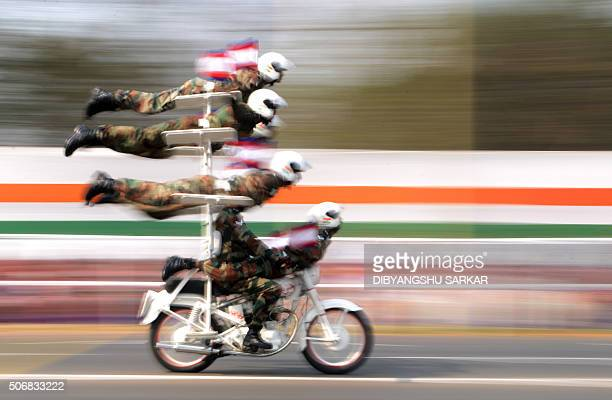 TOPSHOT Indian military personnel perform on a motorbike during a parade to mark Republic Day in Kolkata on January 26 2016 Celebrations are underway...