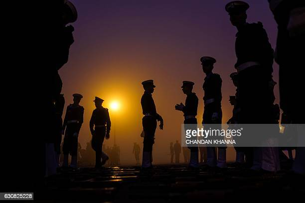 TOPSHOT Indian military personnel prepare to march as they rehearse for the forthcoming Republic Day parade at Rajpath in New Delhi on January 3 2017...