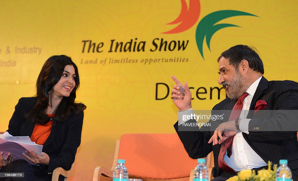 Indian Minister for Commerce and Industry Anand Sharma (R) talks with Shereen Bhan, Indian journalist and news anchor for CNBC-TV18, during the the 2nd India-ASEAN Business Fair and Business Conclave in New Delhi on December 18, 2012. Trade and commerce ministers from ten ASEAN countries are attending the two-day conference.