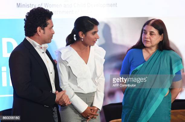 Indian Minister for Women and Child Development Maneka Gandhi interacts with former cricketer and UNICEF Goodwill Ambassador Sachin Tendulkar and...
