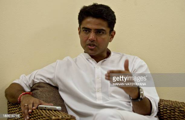 Indian Minister of Corporate Affairs Sachin Pilot gestures during an interview with AFP at his residence in New Delhi on September 27 2013 AFP PHOTO/...