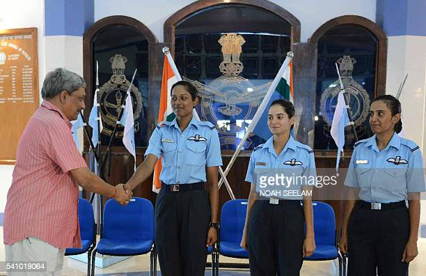 Indian Minister of Defence Manohar Parrikar congratulates three of the Indian Air Force's fighter pilots Bhawana Kanth Avani Chaturvedi and Mohana...