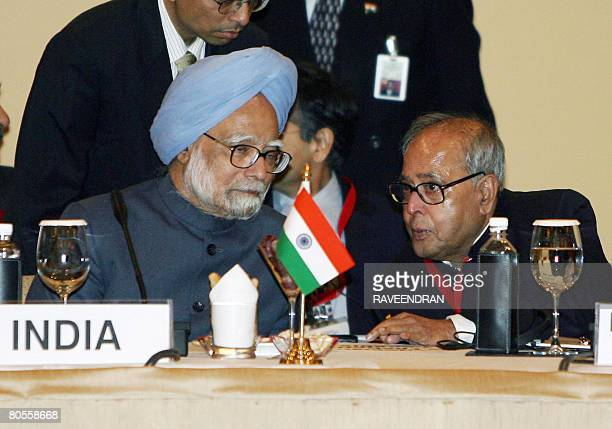 Indian Minister of External Affars Pranab Mukherjee talks with Indian Prime Minister Manmohan Singh during a Meeting for Heads of State and Heads of...