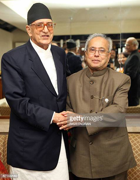 Indian Minister of Foreign Affairs Pranab Mukherjee poses for photographers with Nepal's Prime Minister Girija Prasad Koirala during the 15th South...