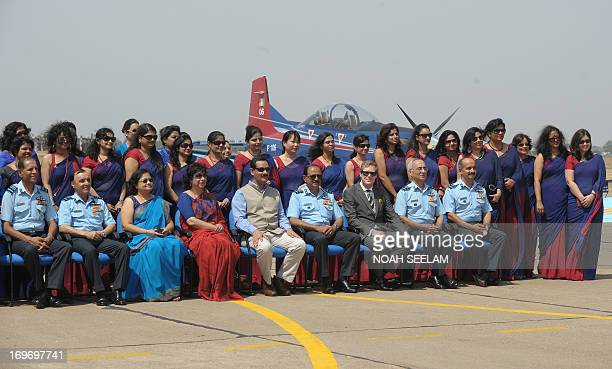 Indian Minister of State for Defence Shri Jitendra Singh poses with wives of Indian Air Force Pilots in front of Pilatus PC7 Swiss made aircraft...