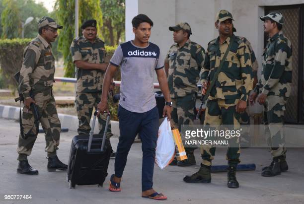 Indian missing Sikh pilgrim Amarjit Singh walks after returning from Pakistan at the Integrated Check Post of the IndiaPakistan Wagah border some 35...