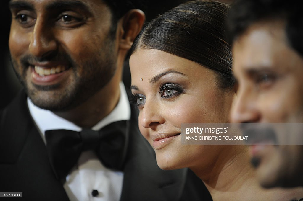 Indian model Aishwarya Rai and husband Abhishek Bachchan (L) arrive for the screening of 'Outrage' presented in competition at the 63rd Cannes Film Festival on May 17, 2010 in Cannes.