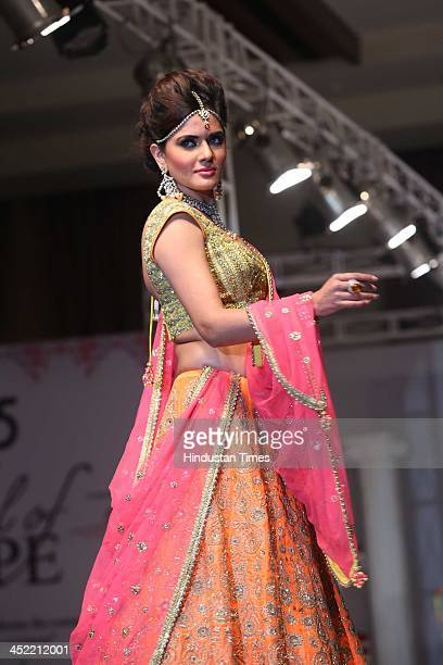 Indian model Amanpreet Wahi walks on the ramp during a fashion show 'The Festival of Hope' dedicated to cancer survivors where cancer survivors...