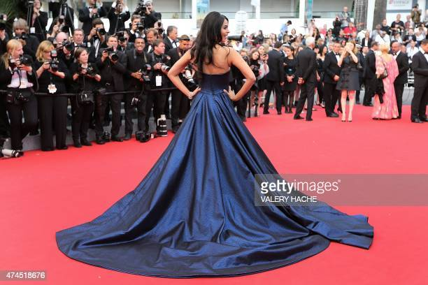 Indian model and actress Mallika Sherawat poses as she arrives for the screening of the film Macbeth at the 68th Cannes Film Festival in Cannes...