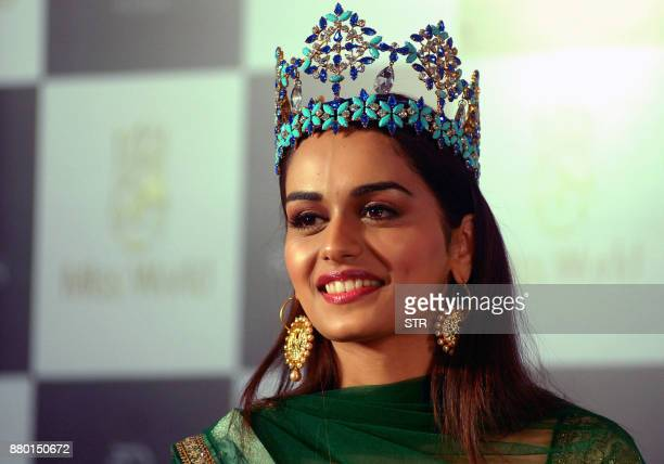 Indian model and Miss World 2017 winner Manushi Chhillar takes part in her first press conference after returning to India from the event in China in...