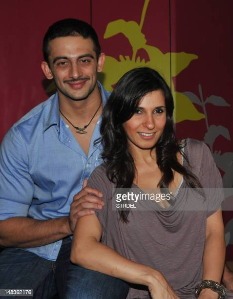 Indian model Arunoday Singh and VJ Ramona pose during a Costa Coffee social event in Mumbai on July 14 2012 AFP PHOTO/STR