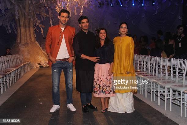 Indian model Freddy Daruwala fashion designer Manish Malhotra with Bollywood director Zoya Akhtar and actor Bhumi Pednekar during the opening show of...