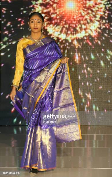 Indian model wearing an elegant and ornate Kanchipuram saree during a South Asian bridal fashion show held in Scarborough Ontario Canada