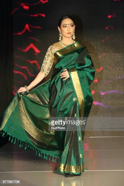 Indian model wearing an elegant and ornate Kanchipuram saree during a South Indian bridal fashion show held in Scarborough Ontario Canada