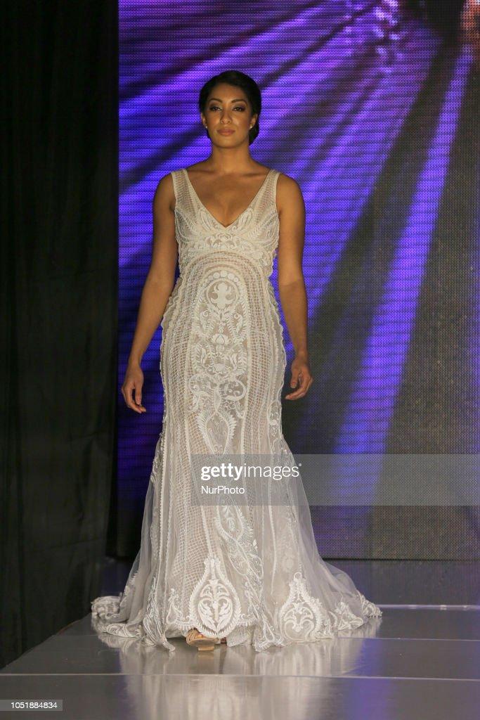Indian model wearing an elegant white wedding dress during a South ...