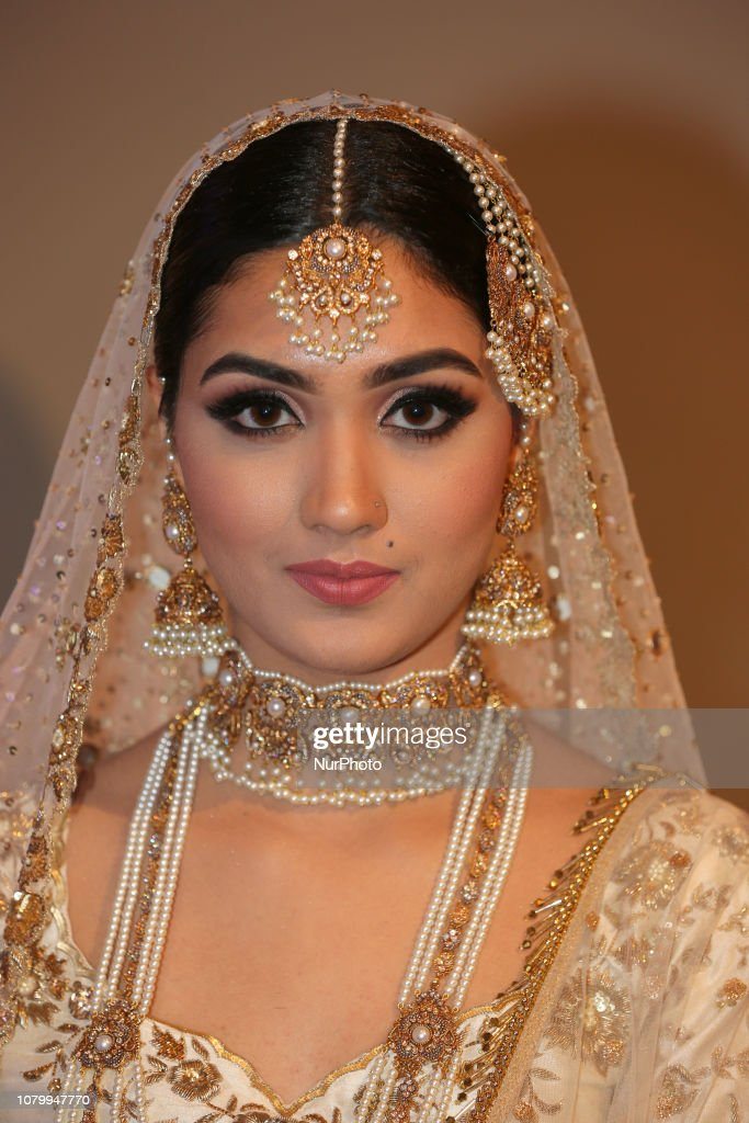 Indian Model Wearing An Exquisite Bridal Lehenga With Traditional
