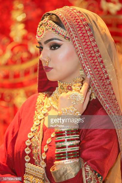 Indian model wearing an exquisite bridal lehenga with traditional opulent jewellery during the Lavish Dulhan bridal show in Toronto Ontario Canada...