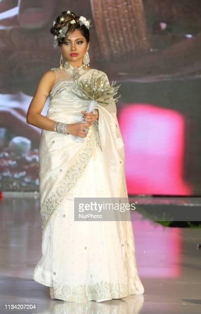 Indian model wearing an exquisite bridal saree during a South Indian bridal fashion show in Markham Ontario Canada