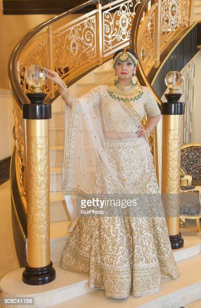 Indian model wearing an exquisite Gujarati bridal lehenga with traditional opulent jewellery in Scarborough Ontario Canada