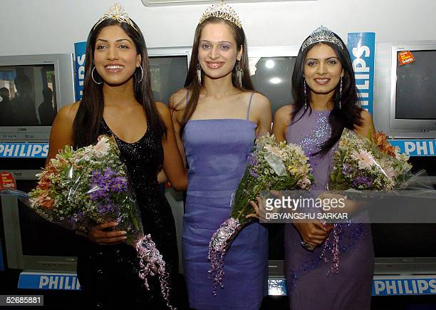 Indian models and winners of the recently concluded Miss India 2005 contest R/L Niharika Singh 'Earth' Amrita Thappar 'Universe' and Sindhura Gadde...