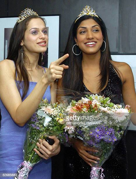 Indian models and winners of the recently concluded Miss India 2005 contest L/R Amrita Thappar 'Universe' and Sindhura Gadde 'World' pose for...