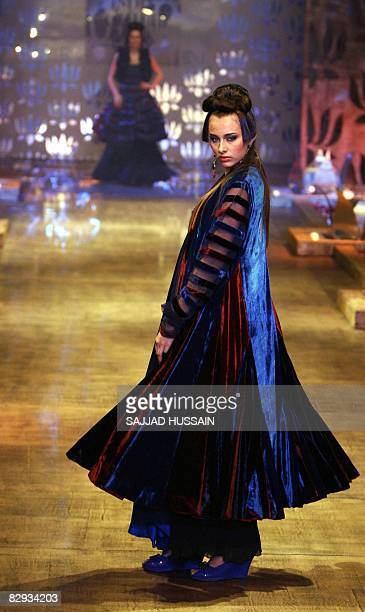 Indian models display creations by Indian designer Rohit Bal on the final day of the HDIL India Couture Week in Mumbai on September 21 2008 India is...