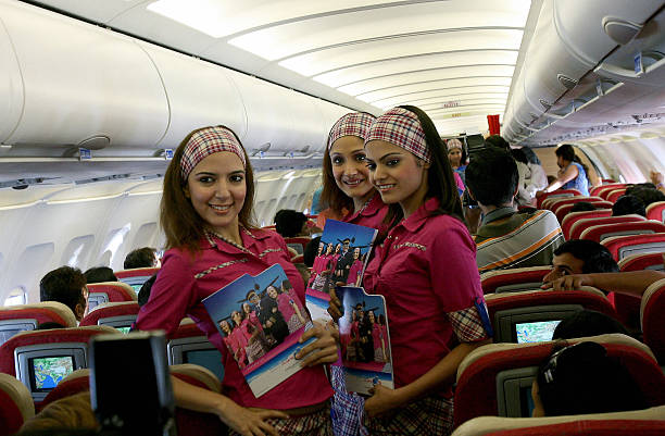 Indian models pose in uniforms of the `FlyingCats` Air Hostess training school on an aircraft enroute to Chandigarhin this 10 August 2006 file...