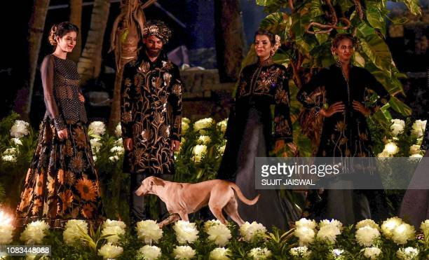 Indian models showcase a spring summer collection 'GulDastah' by designer Rohit Bal at the Blenders Pride Fashion Tour in Mumbai on January 16 2019