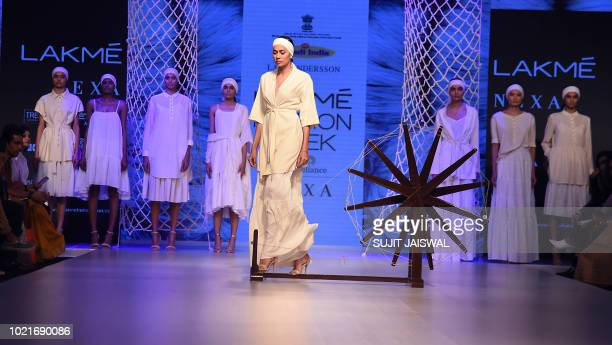 Indian models showcase creations by designer Lars Andersson in collaboration with Khadi and Village Industries Commission at the Lakme Fashion Week...