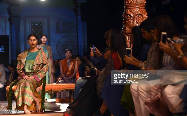 Indian models showcase creations by designer Sunita Shankar in collaboration with the Khadi and Village Industries Commission at the Lakme Fashion...