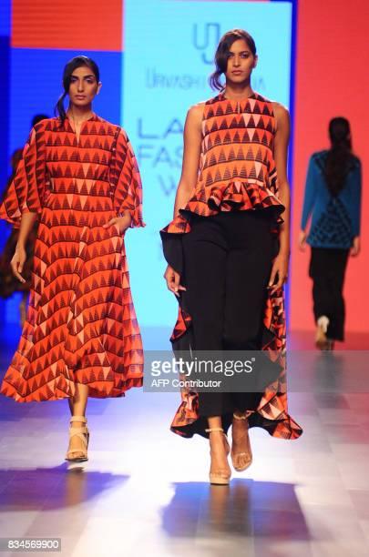 Indian models showcase creations by designer Urvashi Joneja at Lakme Fashion Week Winter /Festive 2017 in Mumbai on August 18 2017 Lakme Fashion Week...
