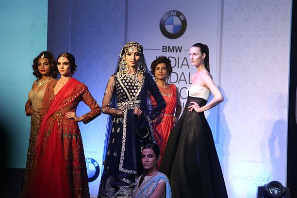 Indian models showcasing designer collections during the launch of BMW India Bridal Fashion Week 2015 along with unveiling of the BMW 6 Series Gran...