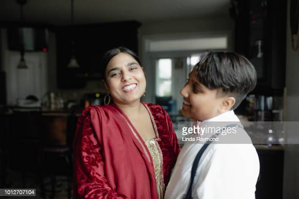 indian mother with here son - indian girl kissing stock photos and pictures